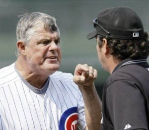 Chicago Cubs manager Lou Piniella argues with first base umpire Rob Drake after Drake ejected first base coach Matt Sinatro, and called Mark DeRosa out at first during the ninth inning of a baseball game against the Florida Marlins at Wrigley Field in Chicago, Saturday, July 26, 2008. (AP Photo/Charles Rex Arbogast)